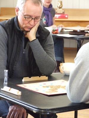 Scrabble player John McKinnon studying his next move.