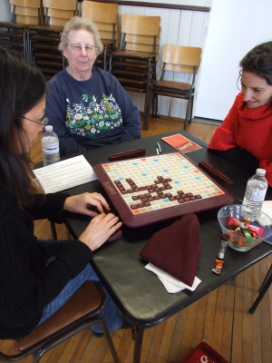 Alice (centre) seems pleased with her scrabble letters while Lily (left), Committee Treasurer ponders her move and Sarah(right) exudes winning confidence.