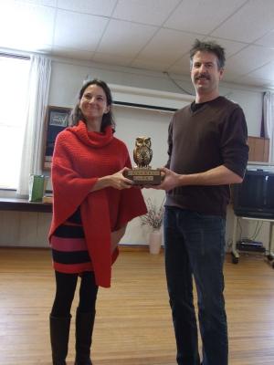 "The Winner is Sarah Keelan-Bishop accepting the ""Hoot"" award from award maker Glen Wallis."