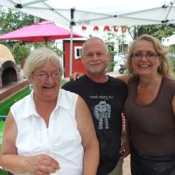 Cheryl, Bob and Linda serving yummy pizza.