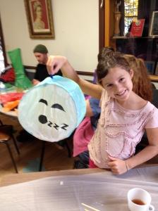 Happy lantern maker with her sleepy moon!