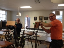 John and Ray installing new backs on all our chairs
