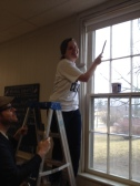 Tess installing new blinds.